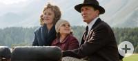 Ehepaar mit Tochter auf einer Kutsche